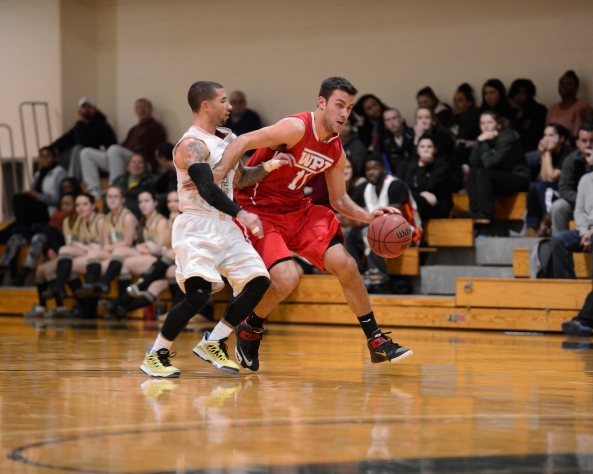 WPI's Zach Karalis recorded a layup with two seconds remaining on Saturday, which lifted the Engineers past Babson in the NEWMAC semifinals! (Photo Credit: WPI Athletics)