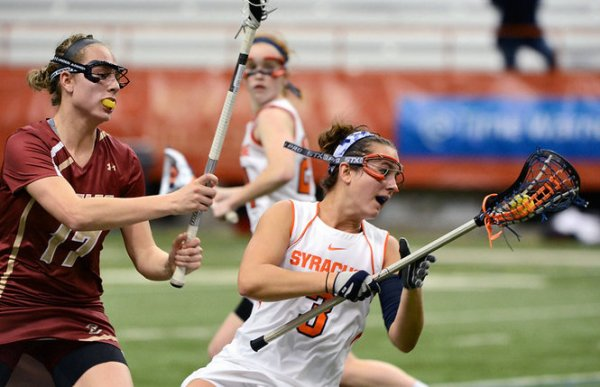 Boston College's Mikaela Rix (left) netted four goals on Saturday, which lifted the Eagles to their second consecutive conference win! (Photo Credit: Syracuse.com)