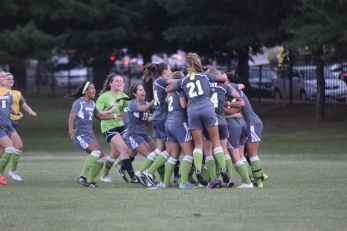 Lesley University celebrates following its exciting overtime win over Tufts University last month. (Photo Credit: Lesley University Athletics).